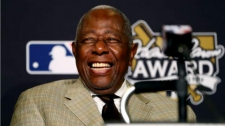 >'A person who works with humility can hammer his way into history' - baseball legend Hank Aaron dies