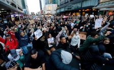 >World's reaction to US weaves solidarity, calls to change