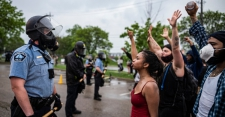 >Tense Protests in Minneapolis and Los Angeles After Police Killing